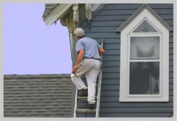 home inspector on ladder